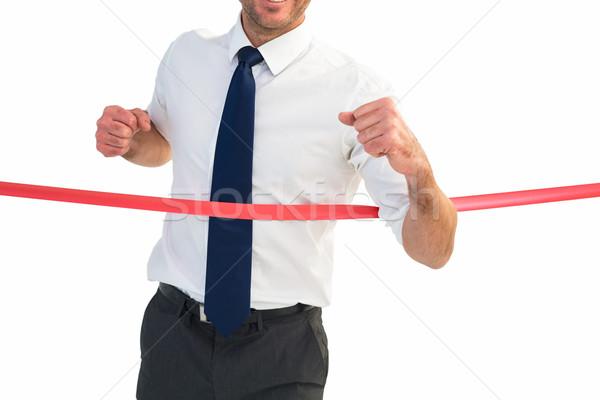 Businessman crossing the finish line Stock photo © wavebreak_media