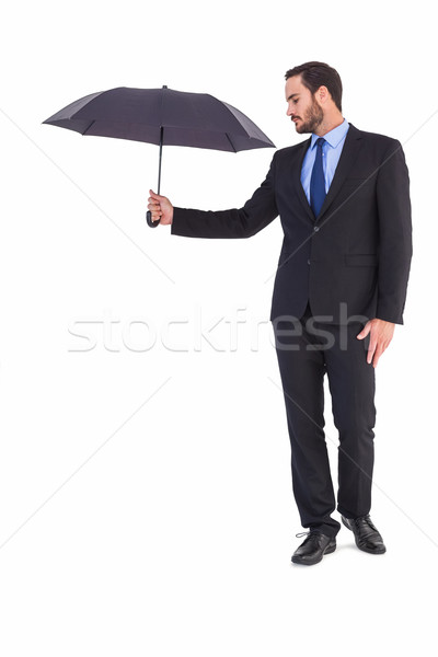 Businesswoman in suit holding umbrella Stock photo © wavebreak_media
