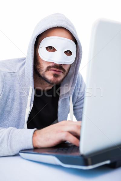 Homem máscara hackers laptop branco Foto stock © wavebreak_media