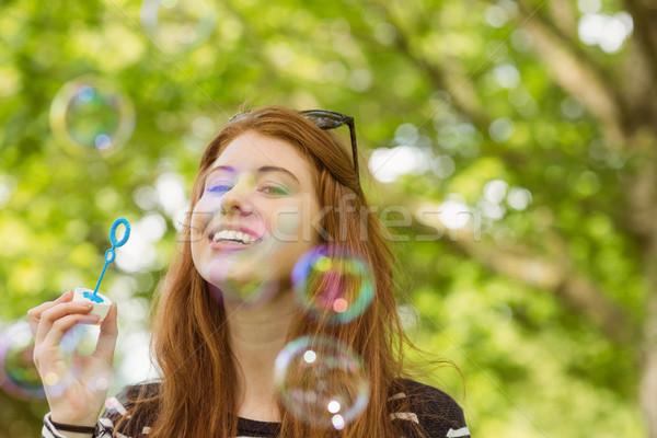 Nő buborékfújás park aranyos fiatal nő boldog Stock fotó © wavebreak_media