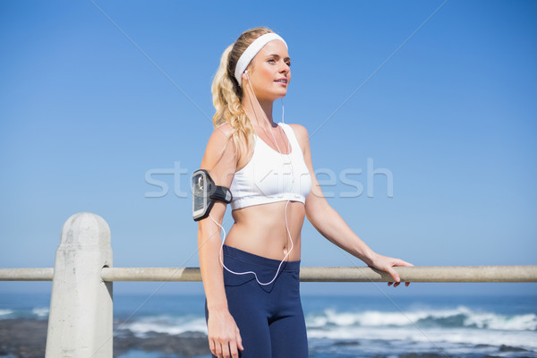 Fit blonde listening to music Stock photo © wavebreak_media