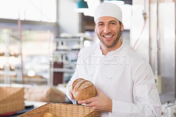 счастливым Бейкер буханка хлеб кухне хлебобулочные Сток-фото © wavebreak_media