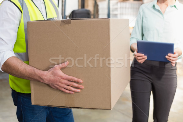 Close up of a warehouse worker carrying box Stock photo © wavebreak_media