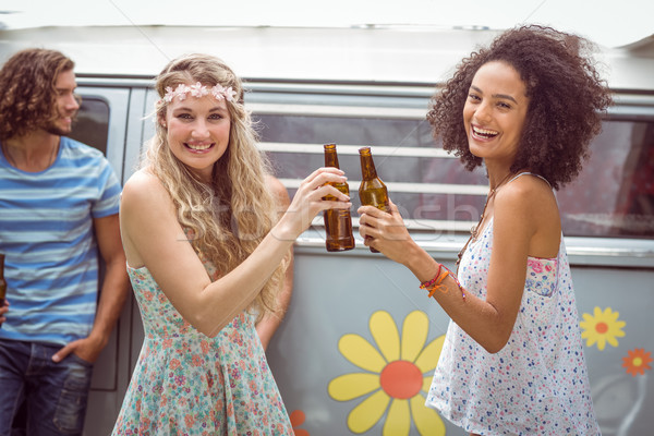 Pretty hipsters toasting with beer Stock photo © wavebreak_media