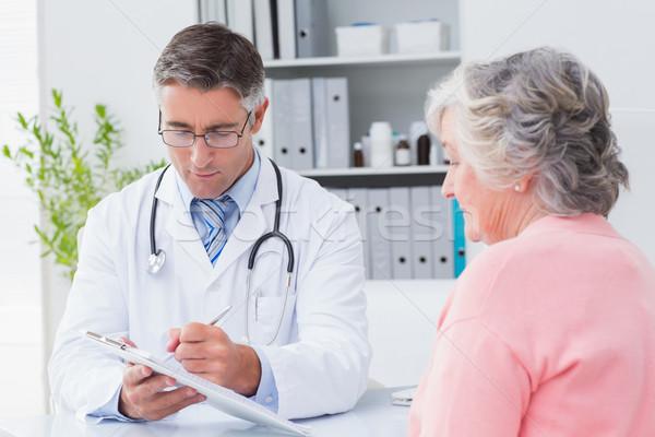Doctor explaining prescriptions to senior woman Stock photo © wavebreak_media