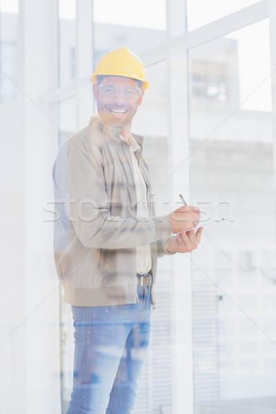 Architect writing on clipboard in office Stock photo © wavebreak_media