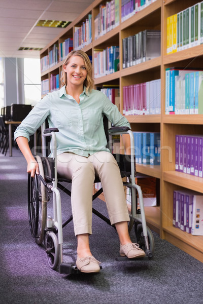 Smiling disabled student in library Stock photo © wavebreak_media