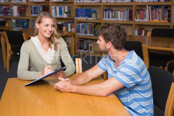 Studente help biblioteca Università iscritto Foto d'archivio © wavebreak_media
