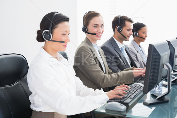 Business people with headsets using computers  Stock photo © wavebreak_media