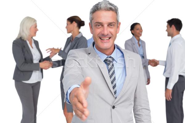 бизнесмен предлагающий рукопожатие белый человека костюм Сток-фото © wavebreak_media