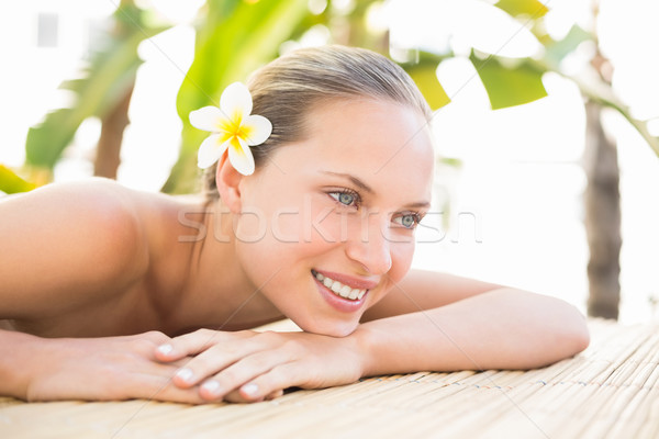 Stock photo: Peaceful blonde lying on massage table