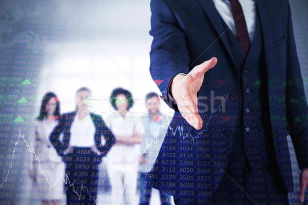 Composite image of businessman ready to shake hand Stock photo © wavebreak_media