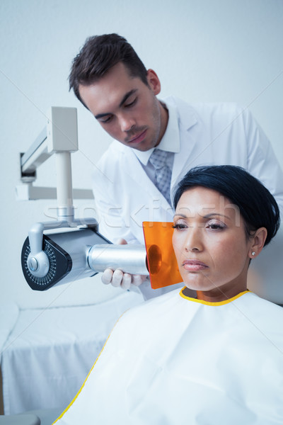 Serious young woman undergoing dental checkup Stock photo © wavebreak_media