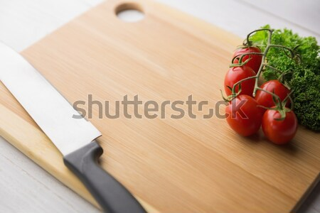 Chopping board tomatoes and parsley Stock photo © wavebreak_media
