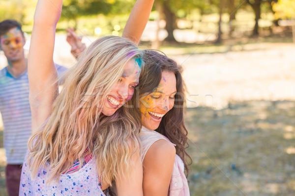 Giovani donne polvere vernice erba Foto d'archivio © wavebreak_media