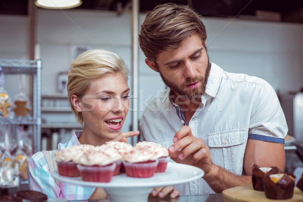 Cute couple on a date choosing cakes  Stock photo © wavebreak_media