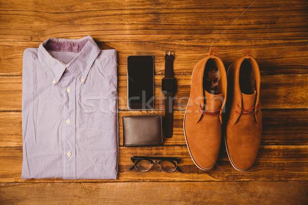 Gömlek ayakkabı gözlük cüzdan ahşap masa Stok fotoğraf © wavebreak_media