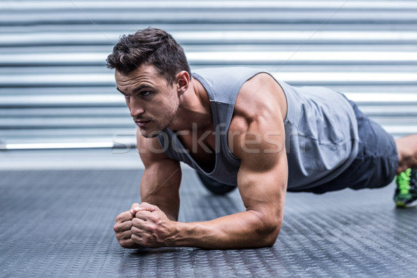 A muscular man on plank position Stock photo © wavebreak_media