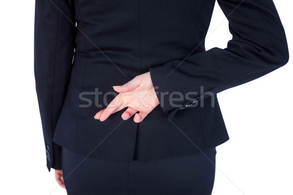 Close up pretty businesswoman with finger crossed  Stock photo © wavebreak_media