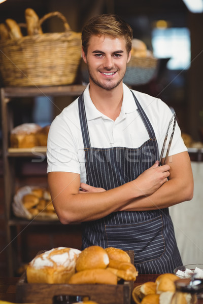 Guapo camarero los brazos cruzados retrato Cafetería pan Foto stock © wavebreak_media