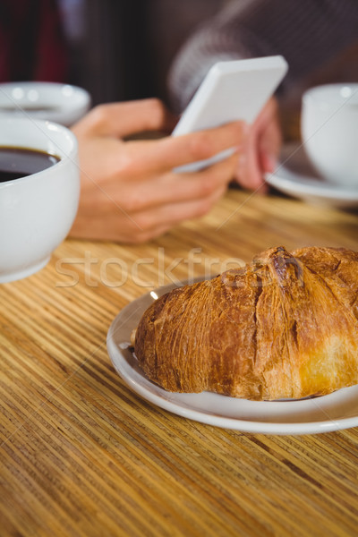 Stock photo: Close up view of cups of coffee and croissant
