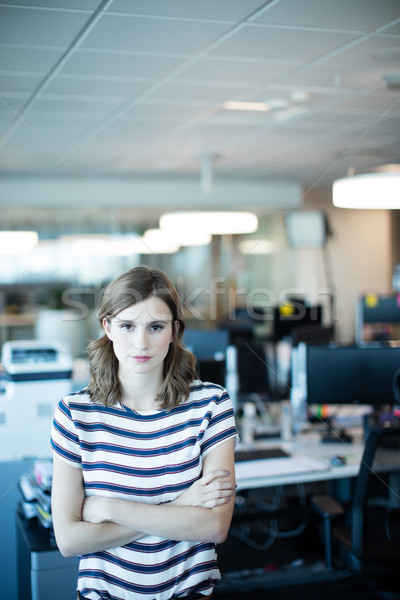 Portrait of young businesswoman with arms crossed Stock photo © wavebreak_media