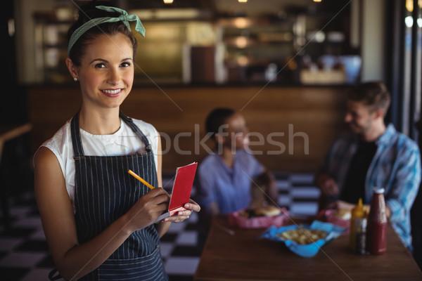 ストックフォト: ウエートレス · 注文 · レストラン · 肖像 · 美しい