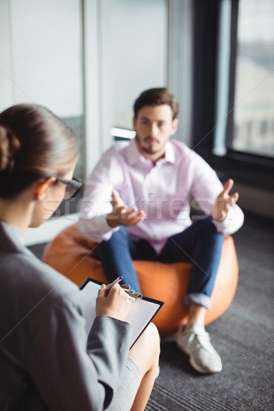 Unhappy man consulting counselor Stock photo © wavebreak_media