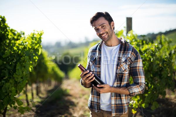 Retrato joven botella de vino vina Foto stock © wavebreak_media