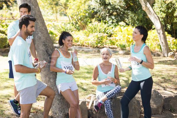 Maraton sportolók elvesz törik park nő Stock fotó © wavebreak_media