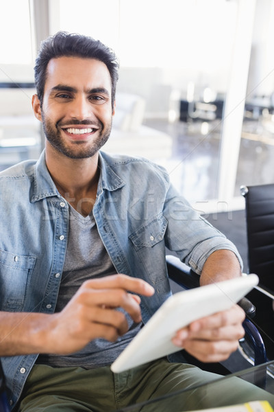 Portrait of smiling businessman using digital tablet while sitting on wheelchair Stock photo © wavebreak_media