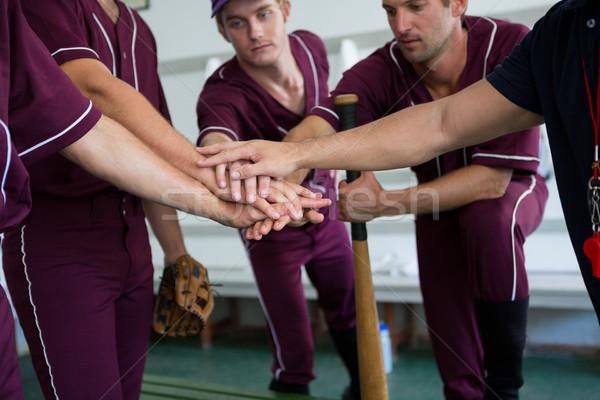 Close up of baseball team doing high five Stock photo © wavebreak_media