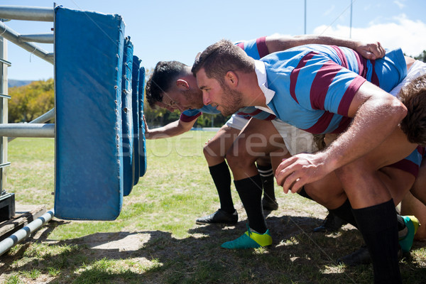 Side view of rugby players crouching at field Stock photo © wavebreak_media