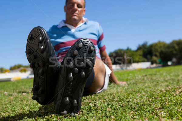Full length of rugby player sitting on field Stock photo © wavebreak_media