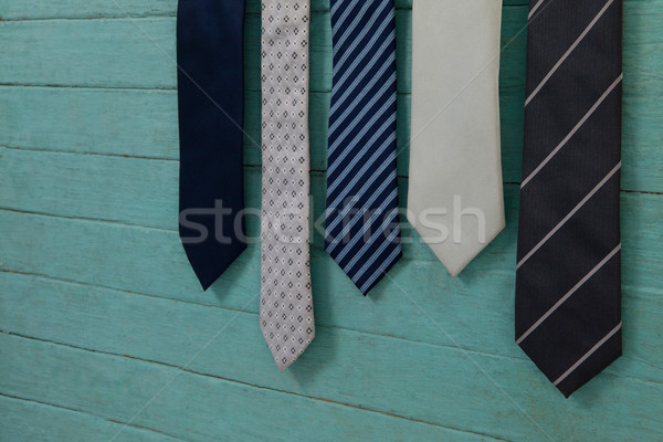 Close up of various neckties hanging by green wall Stock photo © wavebreak_media