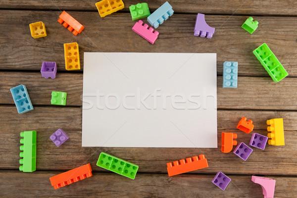 Blocks and blank paper on wooden plank Stock photo © wavebreak_media