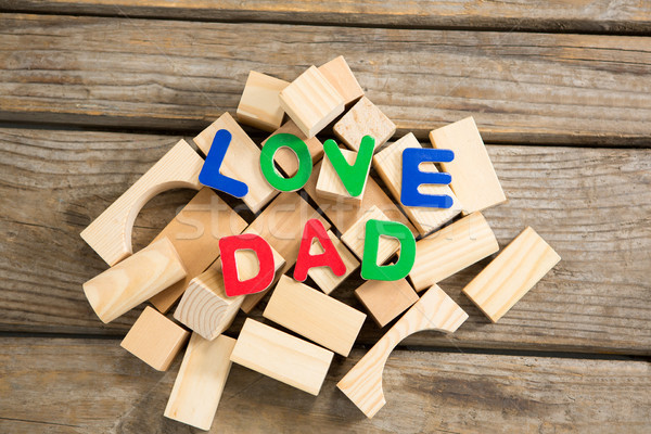 Stock photo: High angle view of love dad text on wooden blocks
