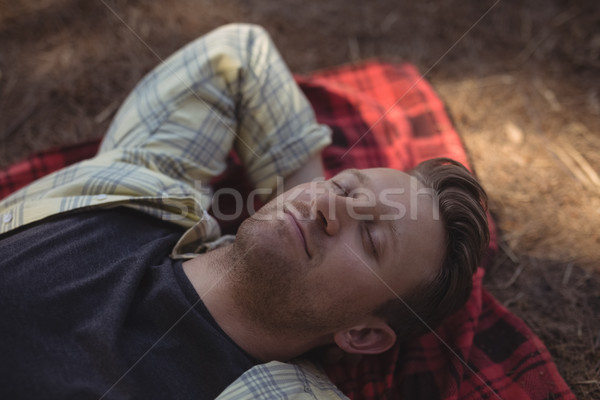 Young man sleeping on mat at farm Stock photo © wavebreak_media