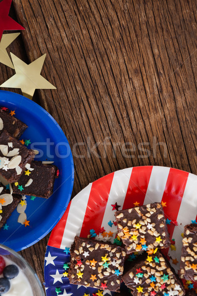 Various sweet foods arranged on wooden table Stock photo © wavebreak_media