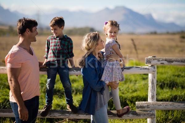 Happy family having fun in park Stock photo © wavebreak_media