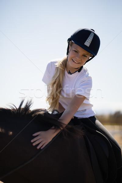 улыбаясь девушки верховая езда лошади ранчо портрет Сток-фото © wavebreak_media