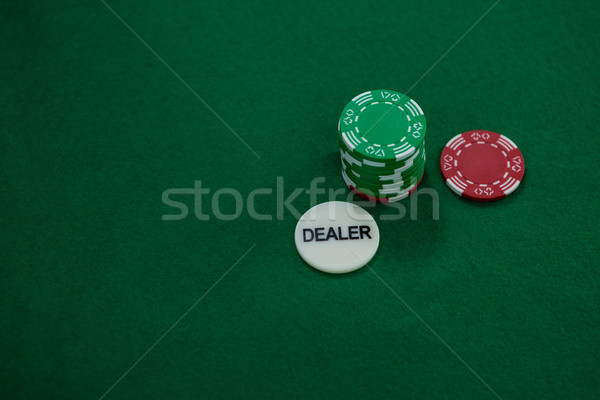 High angle view of dealer coin with chips Stock photo © wavebreak_media