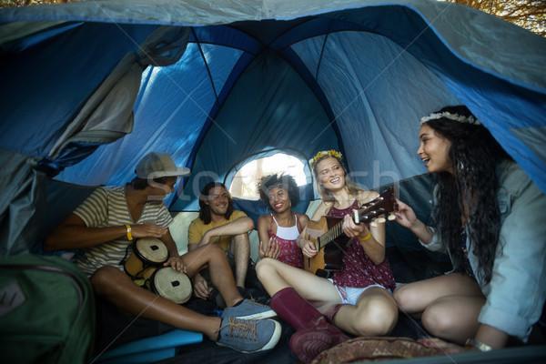 Happy young friends enjoying in tent Stock photo © wavebreak_media