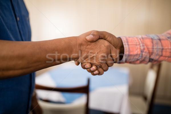 Cropped image of senior friends doing handshake Stock photo © wavebreak_media