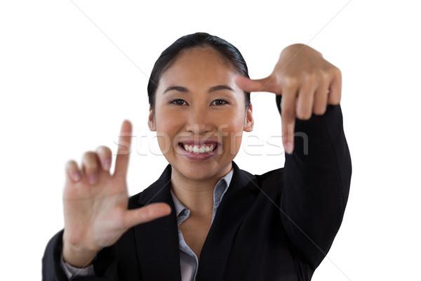 Foto stock: Retrato · sorridente · empresária · dedo · quadro