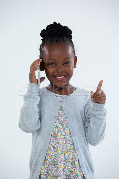 Portrait of smiling businesswoman pointing while talking on phone Stock photo © wavebreak_media