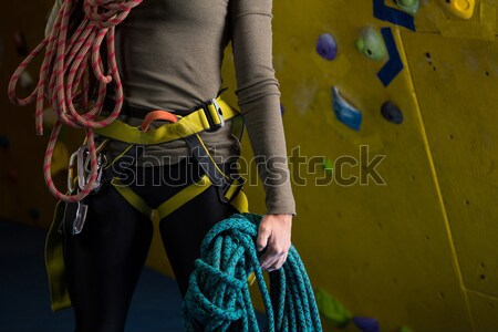 Stock photo: Mid section of woman wearing safety harness