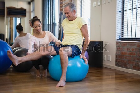 Physiotherapist giving physical therapy of leg to senior patient Stock photo © wavebreak_media