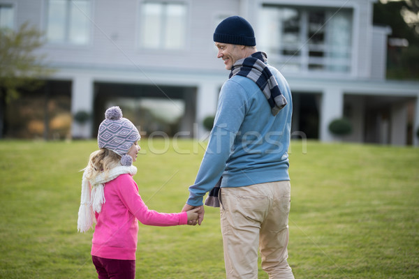 Stock photo: Daughter and father holding hands in the garden