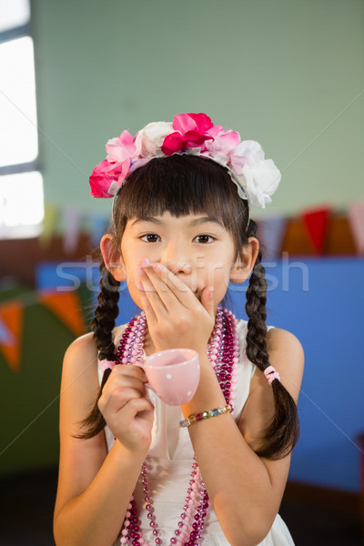 Portrait of cute girl holding teacup during birthday party Stock photo © wavebreak_media